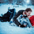 Happy Young Couple in Winter Park having fun.Family Outdoors. love kiss — Stock Photo #37782859