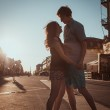 Young couple kissing over sunset — Stock Photo