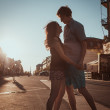 Young couple kissing over sunset — Stock Photo #37783413