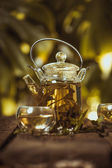 Hot glass of tea on wood table — Stok fotoğraf