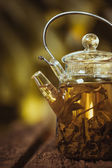 Hot glass of tea on wood table — Foto Stock