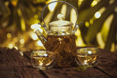 Hot glass of tea on wood table — Stock Photo