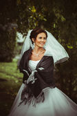 Beautiful bride outdoors in a forest. — Stock Photo