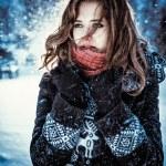 Beautiful brunette girl blowing star dust - winter portrait — Stock Photo