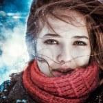 Beautiful brunette girl blowing star dust - winter portrait — Stock Photo #43163799