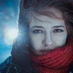 Beautiful brunette girl blowing star dust - winter portrait — Stock Photo #43163825