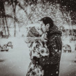 Young couple kissing on snow. Black and white. — Stock Photo #43163953