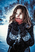 Beautiful brunette girl blowing star dust - winter portrait — Stok fotoğraf