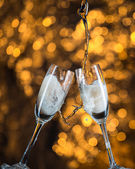 New Year's at midnight with champagne glasses on light background — Stock Photo