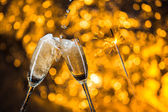 New Year's at midnight with champagne glasses on light background — Stockfoto