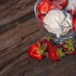 Ice cream with strawberries and whipped cream — Stock Photo #47858743