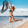 Jumping happy girl on the beach, fit sporty healthy sexy body in bikini — Stock Photo #50845017