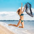 Jumping happy girl on the beach, fit sporty healthy sexy body in — Stock Photo #50845035