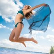 Jumping happy girl on the beach, fit sporty healthy sexy body in bikini — Stock Photo #50845115