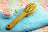 Wooden brush with a handle for body massage , towel and objects — Stock Photo