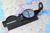 A compass and a map of the North of Russia — Stock Photo