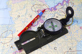 Compass, pencil and a fragment of the map of the North of Russia — Stock Photo