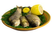 Three carp on ceramic dish , greens and lemon — Foto Stock