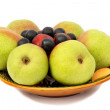 Pears, plums and prunes on plate on white background. — Stock Photo #30407441