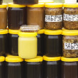 Different varieties of honey in banks, offered for sale at the f — Stock Photo