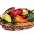 Red, yellow and green pepper in a basket on a white background. — Stock Photo