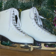 New year's gift - the beautiful woman skates. — Stock Photo