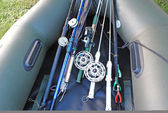 Prepared for fishing, spinning, fishing rods, rubber boat. — Stock Photo