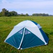 Stock Photo: Private camping tent on meadow near river.