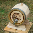 Stock Photo: Wooden oak barrel wine, beer with metal crane. Sold at fair.