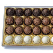 Chocolate sweets in the box on the white background. — Stock Photo
