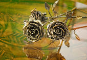 The shiny metal forged roses, handmade — Stock Photo
