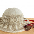 Female summer hat for protection against the sun on a white back — Stock Photo #49853917