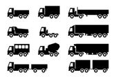 Set of silhouettes the cargo trucks. — Stock Vector