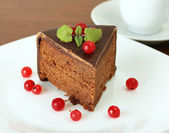 Chocolate cake with red currant — Stock Photo