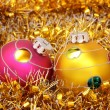 Two christmas balls on gold tinsel  — Stock Photo