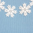 Winter background: knitted fabric and snowflakes  — Stock Photo