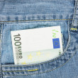 One hundred euro banknote in jeans pocket — Stock Photo