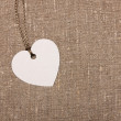Heart shape label tag on sackcloth — Stock Photo