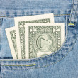 Stock Photo: Dollars in jeans pocket