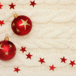 Christmas card: stars balls on knitting background — Stock Photo