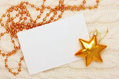 Christmas card: blank, star and beads on knitting background — Stock Photo