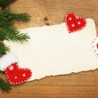 Blank Old Paper Sheet with Christmas tree and felt handmade decorations on wooden background — Stock Photo #36214577