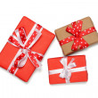 Three gift boxes with ribbon bows, isolated on white — Stock Photo #39367447
