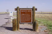 NEAR SOCORRO, NEW MEXICO, USA-OCT 6: A road side Historical Marker on U.S. Route 380, marks the area known as Trinity Site, location of the world's first atomic bomb detonation. Photographed in 2011. — Stock Photo
