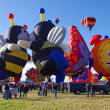 ALBUQUERQUE, NEW MEXICO, USA - OCTOBER 08: Special Shape hot air balloons were featured at the 40th edition of the Albuquerque International Balloon Fiesta held in October 2011. — Stock Photo