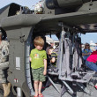 McGUIRE AIR FORE BASE-WRIGHTSTOWN, NEW JERSEY, USA-MAY 12: Children of all ages are seen touring a U.S. Army helicopter on static display during the base's Open House held on May 12, 2012. - Stock fotografie