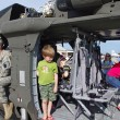 McGUIRE AIR FORE BASE-WRIGHTSTOWN, NEW JERSEY, USA-MAY 12: Children of all ages are seen touring a U.S. Army helicopter on static display during the base's Open House held on May 12, 2012. - Stok fotoğraf