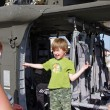 McGUIRE AIR FORE BASE-WRIGHTSTOWN, NEW JERSEY, USA-MAY 12: A young boy is all smiles as he prepares to step out of a U.S. Army helicopter after touring it during the base's Open House on May 12, 2012. - Lizenzfreies Foto