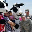 McGUIRE AIR FORE BASE-WRIGHTSTOWN, NEW JERSEY, USA-MAY 12: Everyone was having their picture taken with the EAT MOR CHIKIN Chick-fil-A mascots during the base's Open House held on May 12, 2012. — Stock Photo