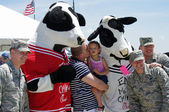 "McGUIRE AIR FORE BASE-WRIGHTSTOWN, NEW JERSEY, USA-MAY 12: Everyone was having their picture taken with the ""EAT MOR CHIKIN"" Chick-fil-A mascots during the base's Open House held on May 12, 2012. — Stock Photo"